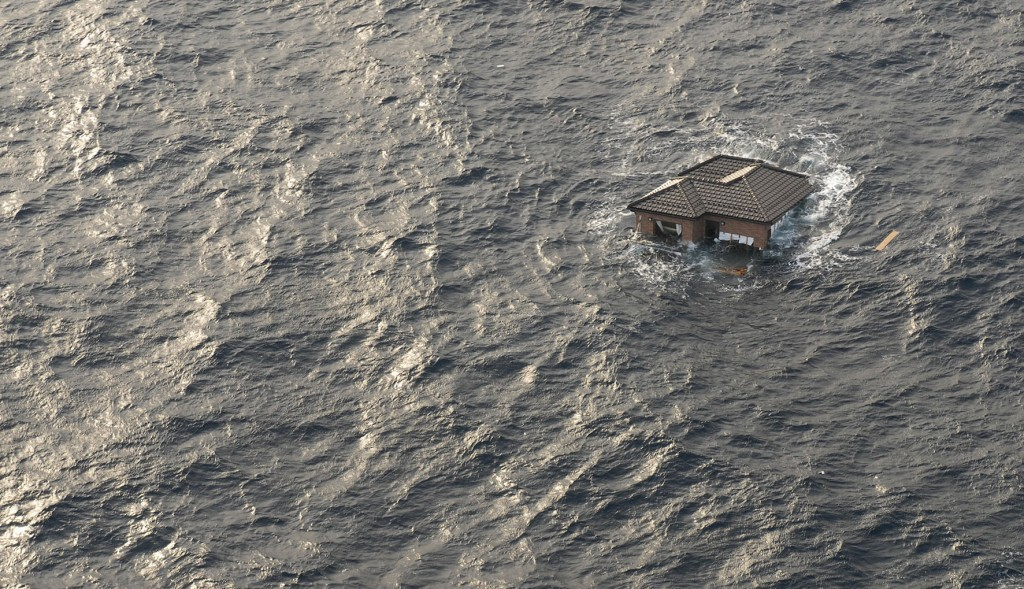 A Japanese home is seen adrift in the Pacific Ocean, in this photograph taken on March 13, 2011 and
