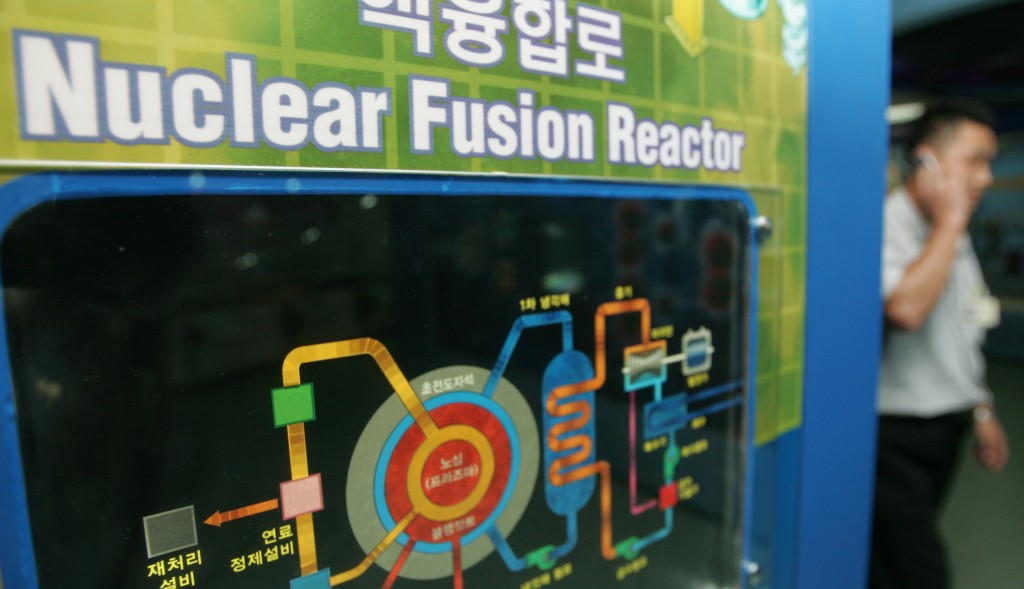 A South Korean walks past a diagram of a nuclear fusion reactor process at a science museum in Seoul September 9, 2004. South Korean government scientists enriched a small amount of plutonium in a one-off experiment in 1982, the Science and Technology Ministry said on Thursday. REUTERS/You Sung-Ho  YSH/SH - RTRAB0L