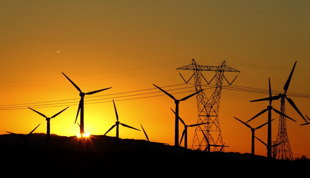 The sun rises behind windmills at a wind farm in Palm Springs, California, February 9, 2011. REUTERS