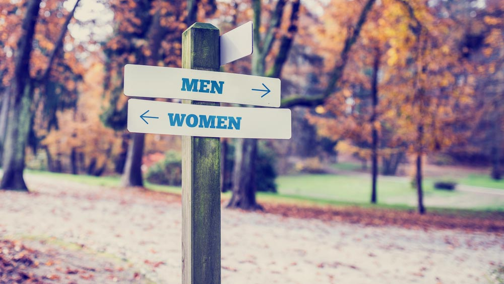 Sign with arrows pointing in different directions for men and women