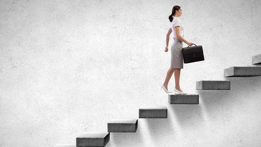 Businesswoman climbing stairs