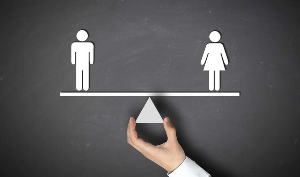 A scale which is equally balanced with a man and a woman on each end
