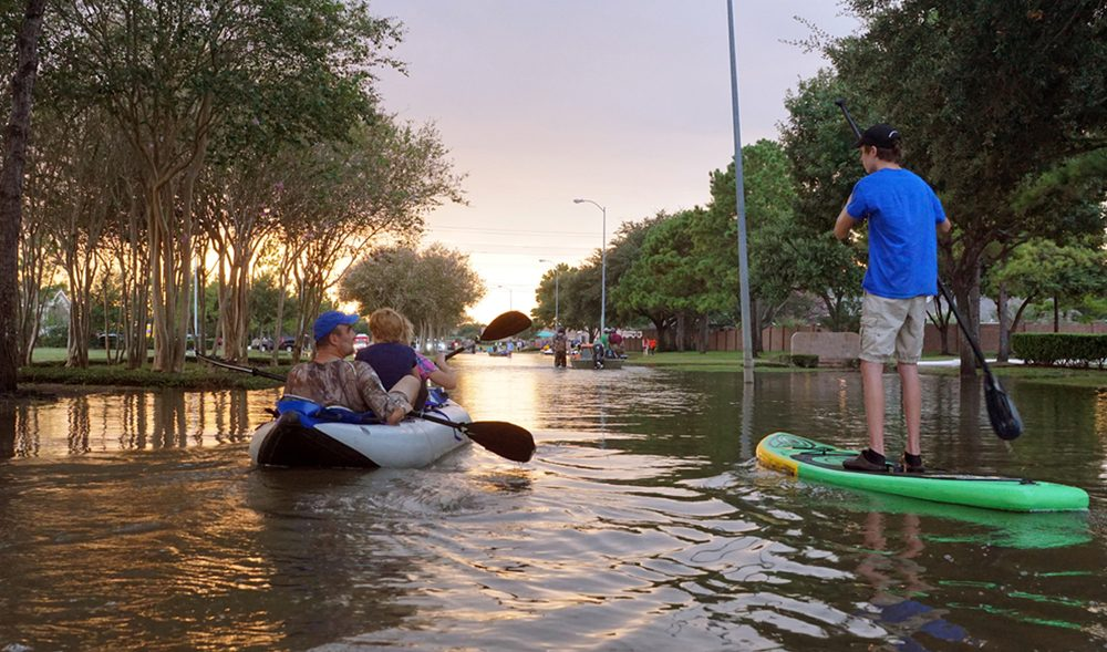 People on kayak's in flooded streets following a hurricane